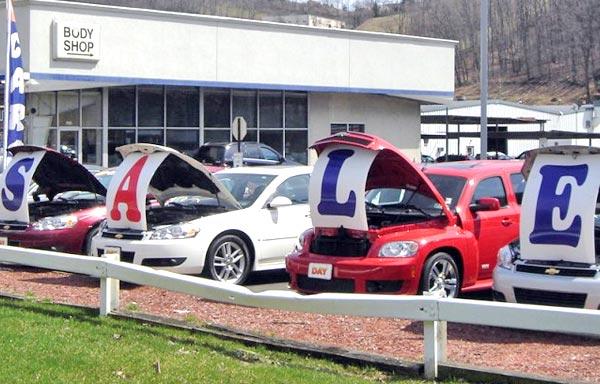new cars parked on dealer