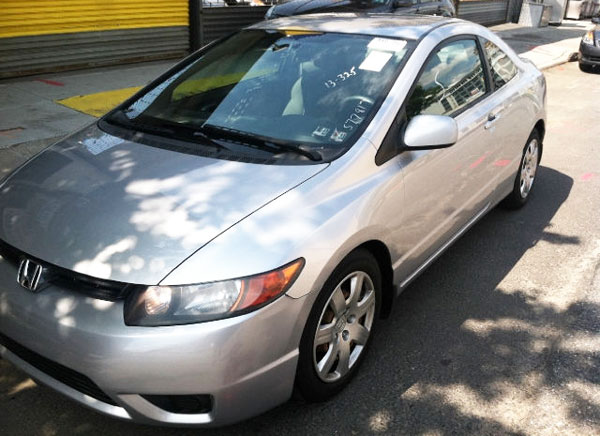 <strong>2006 HONDA CIVIC LX - Asking Price: $5,999</strong> — This Civic 1.8L, silver color, coupe, with leather seats and CD changer, has only 113k miles and could be yours for less than $6000 or $99 per month. If you are interested, It is for sale in <span class='u'>New York, NY</span> by United Auto Sales dealership and you can contact them at 877-885-1303.
