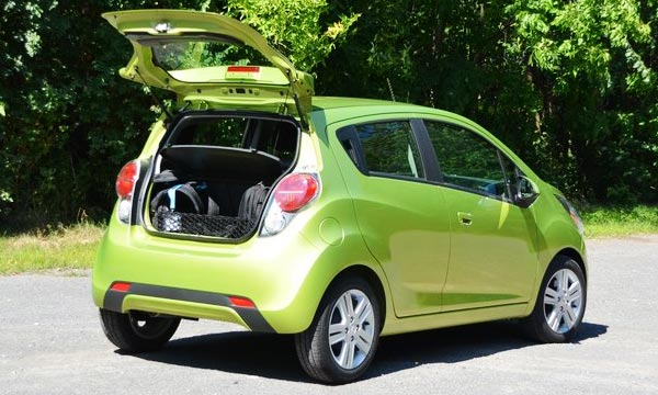 <strong>Photo: 2013 Chevrolet Spark (Rear / Trunk).</strong> One of its benefits is that it offers more cargo and passengers space than other cars of its size as the Fiat 500, Scion iQ or the smart fortwo.