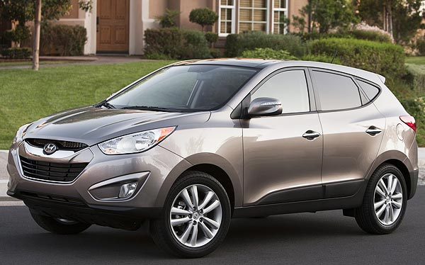 http://www.autopten.com/carforum/images/new-2013-hyundai-tucson-brown.jpg