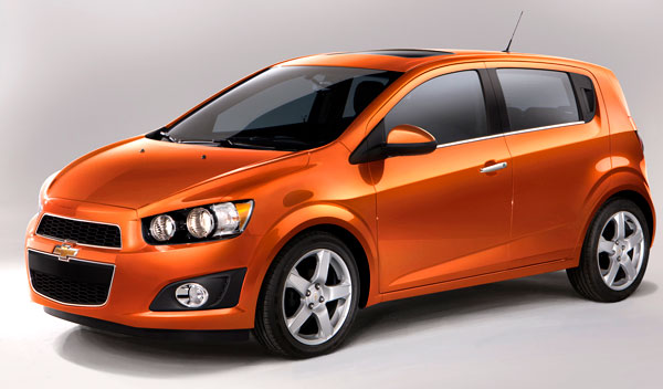 orange 2013 chevrolet sonic hatchback