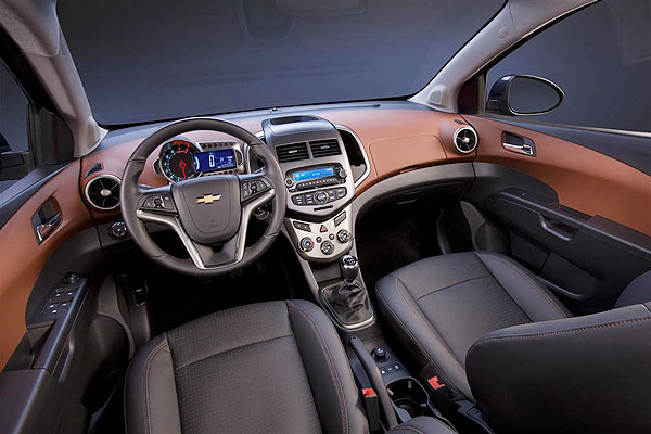orange 2013 chevrolet sonic Two tone leather interior front view
