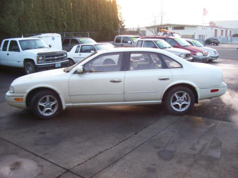 Photo #6: luxury sedan: 1994 Infiniti Q45 (White Cream)