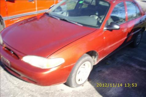 Photo #2: sedan: 1998 Ford Escort (Red)