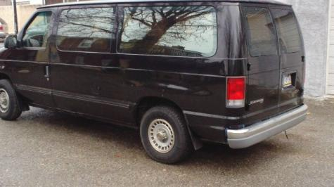 Photo #1: conversion van: 1997 Ford Club Wagon (grey)