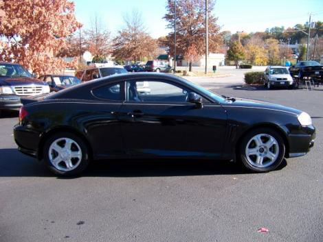 Black Hyundai Tiburon 2004. Jet Black Hyundai Tiburon for